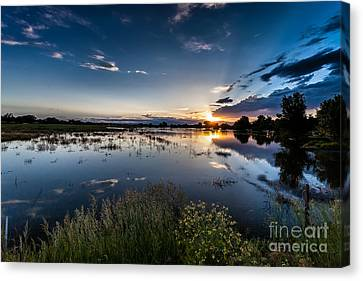 Sunset Over The River Canvas Print by Steven Reed