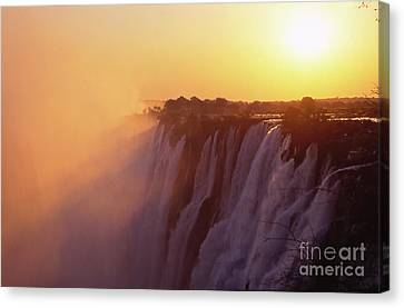 Sunset Over The Victoria Falls Canvas Print by Alex Cassels