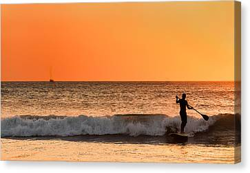 Sunset Paddleboard Surfer Canvas Print by Mary Jo Allen