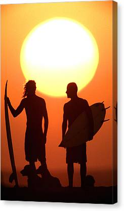 Sunset Surfers Canvas Print by Sean Davey