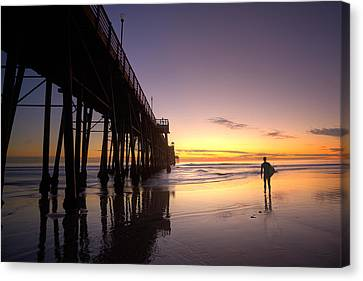 Surfer At Sunset Canvas Print by Peter Tellone