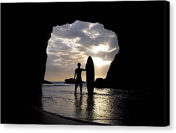 Surfer Inside A Cave At Muriwai New Canvas Print by Deddeda