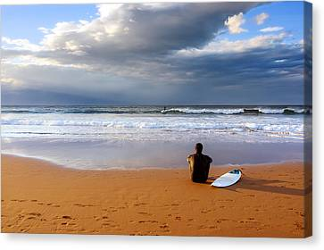 Surfer Sitting And Relaxing On Sand Canvas Print by Mikel Martinez de Osaba