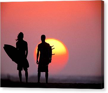 Surfers Sunset Canvas Print by Sean Davey