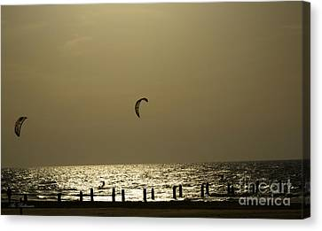 Surfing At Sunset 02 Canvas Print by Arik Baltinester