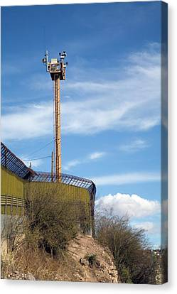 Surveillance Tower At Us-mexico Border Canvas Print by Jim West