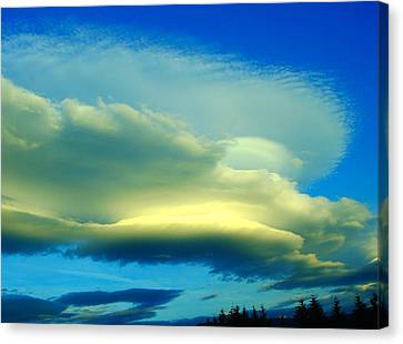 Sweeping Across The Sky Canvas Print by Jeff Swan