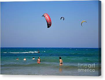 Swimming And Kitesurfing In Prasonisi Canvas Print by George Atsametakis