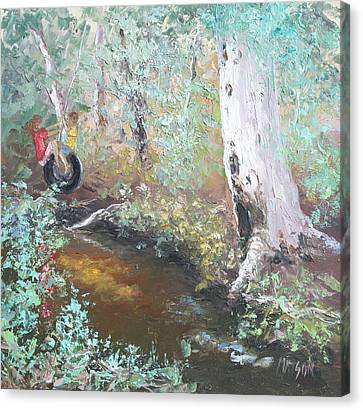 Swinging On The Old Tyre Canvas Print by Jan Matson