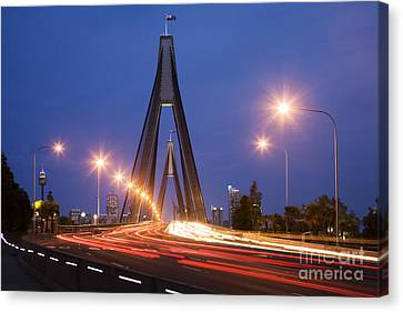 Sydney Traffic And Anzac Bridge At Twilight Canvas Print by Colin and Linda McKie