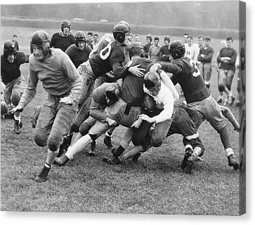 Tackled In The Football Line Canvas Print by Underwood Archives