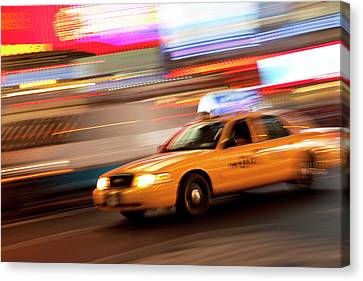 Taxi Cab At Night In Times Square, New Canvas Print by Brian Jannsen