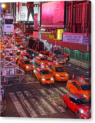 Taxis In Times Square Canvas Print by Dan Sproul