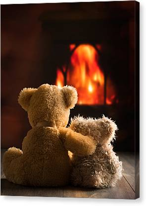 Teddies By The Fire Canvas Print by Amanda Elwell