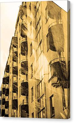 The Building And The Mystery Woman Canvas Print by Toppart Sweden