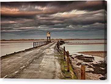 The Causeway From Holy Island Canvas Print by John Short