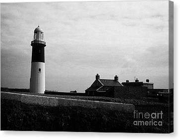 The East Light Lighthouse And Buildings Altacarry Altacorry Head Rathlin Island Against Grey Cloudy  Canvas Print by Joe Fox