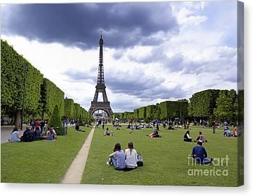 The Eiffel Tower And The Champ De Mars. Paris. France Canvas Print by Bernard Jaubert