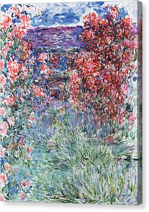 The House At Giverny Under The Roses Canvas Print by Claude Monet