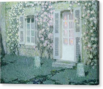 The House With Roses Canvas Print by Henri Eugene Augustin Le Sidaner