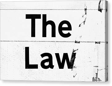 The Law Canvas Print by Tom Gowanlock
