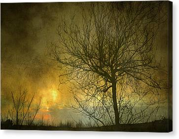 The Light Escapes Through The Clouds Canvas Print by Guido Montanes Castillo