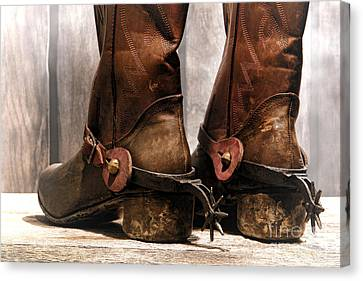 The Muddy Boots Canvas Print by Olivier Le Queinec