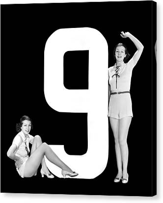 The Number 9 And Two Women Canvas Print by Underwood Archives
