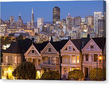 The Painted Ladies And San Francisco Skyline Canvas Print by Adam Romanowicz