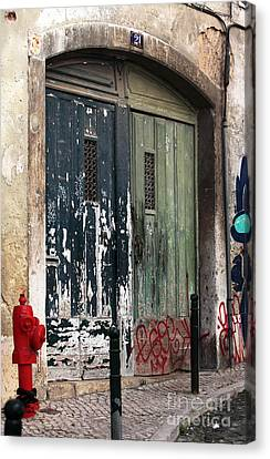 The Red Hydrant Canvas Print by John Rizzuto