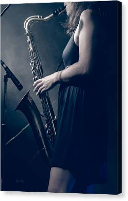 The Saxophonist Sounds In The Night Canvas Print by Bob Orsillo