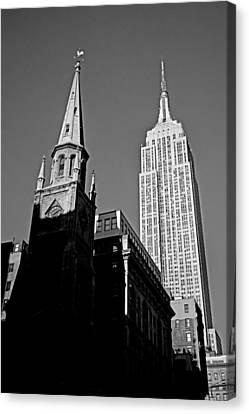 The Skyscraper And The Steeple Canvas Print by Joann Vitali