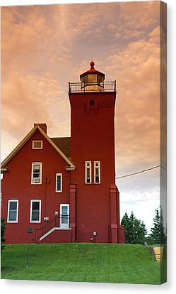 The Two Harbors Lighthouse Overlooking Canvas Print by David R. Frazier