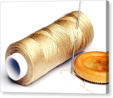 Thread And Button Canvas Print by Sinisa Botas