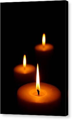 Three Burning Candles Canvas Print by Johan Swanepoel