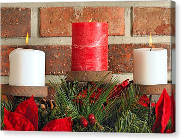 Three Christmas Candles Canvas Print by Kenneth Sponsler