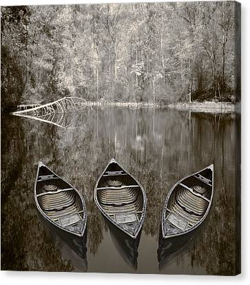 Three Old Canoes Canvas Print by Debra and Dave Vanderlaan