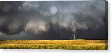 Thunderstorm Advancing Over A Field Canvas Print by Panoramic Images