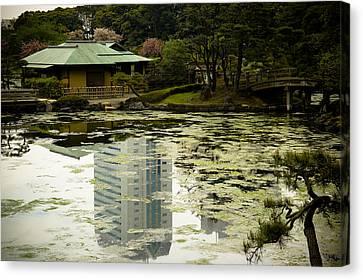 Tokyo Reflection Canvas Print by Sebastian Musial