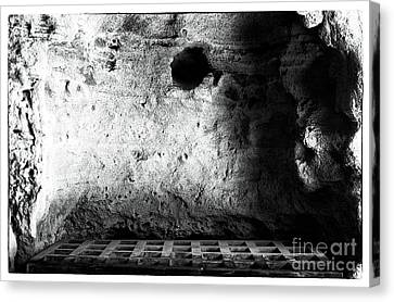 Tomb Of The Dammed Canvas Print by John Rizzuto