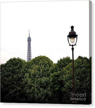 Top Of The Eiffel Tower And Street Lamp. Paris.france. Canvas Print by Bernard Jaubert