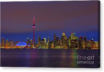 Toronto By Night... Canvas Print by Nina Stavlund