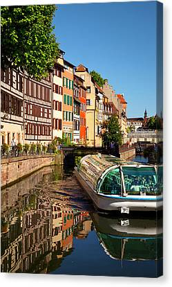 Tour Boat And Buildings Reflected Canvas Print by Brian Jannsen