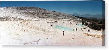Tourists Enjoying The Hot Springs Canvas Print by Panoramic Images