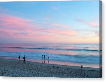 Tourists On The Beach At Sunset, Santa Canvas Print by Panoramic Images