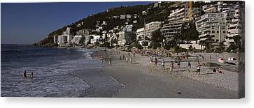 Tourists On The Beach, Clifton Beach Canvas Print by Panoramic Images