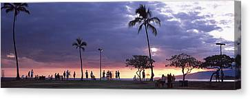 Tourists On The Beach, Honolulu, Oahu Canvas Print by Panoramic Images