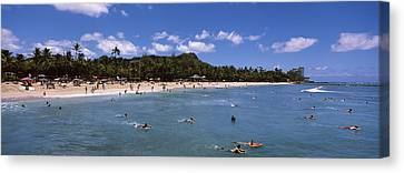 Tourists On The Beach, Waikiki Beach Canvas Print by Panoramic Images