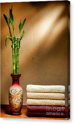 Towels And Bamboo Canvas Print by Olivier Le Queinec