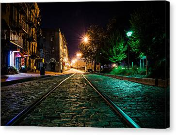Tracks On The Riverwalk At Night Canvas Print by Anthony Doudt